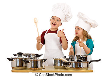 Happy chef and his aid - kids with cooking utensils isolated...