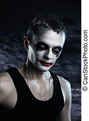 Man joker - Spooky man joker on dark background