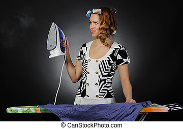 woman stroking men shirt. - woman with curlers on her head...