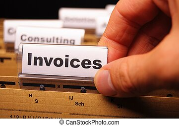 invoice or invoices concept with business folder in office...