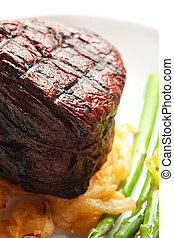 Filet Mignon - Thick Filet mignon served with crispy onions...