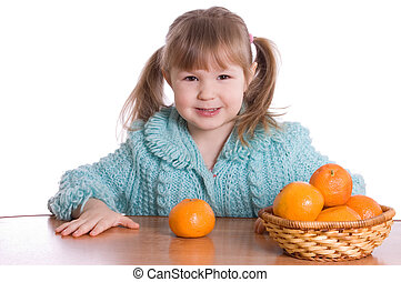 The little girl with tangerines