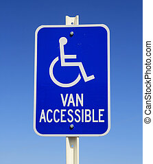 handicapped van parking sign in blue and white on blue sky...