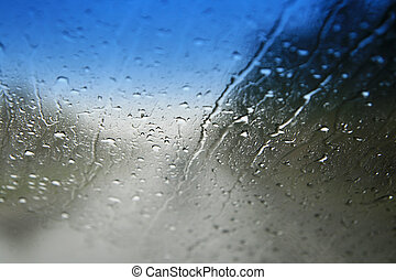 rainy windshield - view through a wet car windshield with...