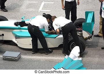 Grand Prix Car Repair - Stalled grand prix car being...