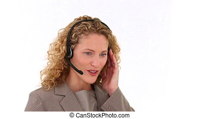 Curly blond haired woman talking on the phone in a call...