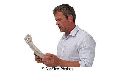 Casual man reading a newspaper