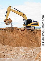 Loader ecavator at sand quarry - Yellow excavator loader at...