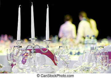 catering service table decoration with stemware and...
