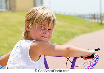 little girl on bicycle outdoors