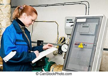 woman engineer in a boiler room - woman engineer checking...
