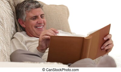 Retired man looking at an album