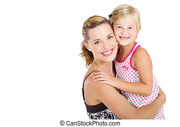 little girl hugging mother