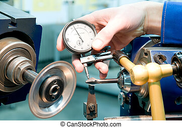 tool quality measuring process - human hand with measuring...