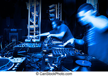 disc-jockey - Image of two disc-jockey with several mixers