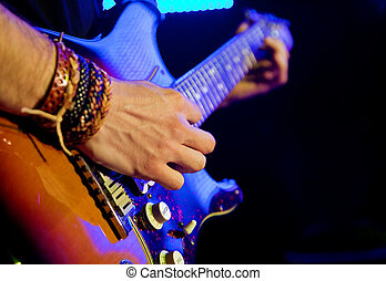 Live music image with guitar in first plane