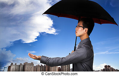 The insurance agent with umbrella and Weather Observation