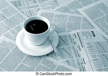 coffee over newspaper - good morning cofffee break with...