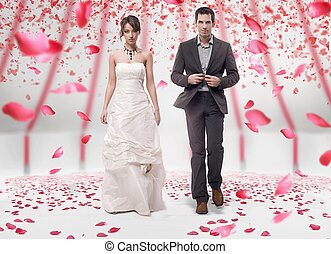 Wedding couple walking in roses