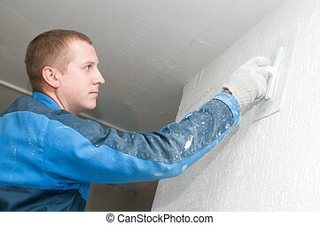 Plasterer at work - Plasterer at indoor renovation...