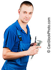 worker with caliper - worker in uniform with caliper and...