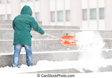 Man shoveling winter snow - communal services worker in...