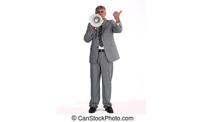 Man in gray suit speaking on a megaphone against a white...