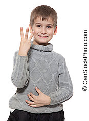 Cute boy smilling and showing three finger isolated on a...