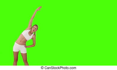 Blond woman doing some relaxation exercises - Chroma-key...