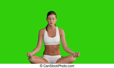Dark haired female doing yoga