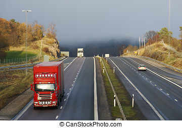 trucking through a mountain pass - large trucks driving...