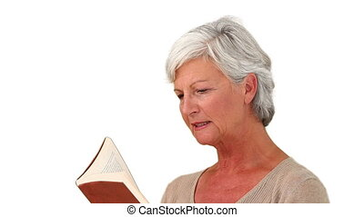 Senior woman reading a book against a white background
