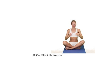 Pretty blond lady doing yoga on her ground cloth