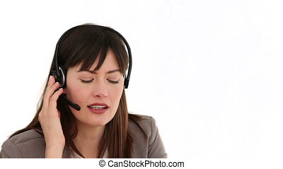 Dark-haired woman having a phone call isolated on a white...