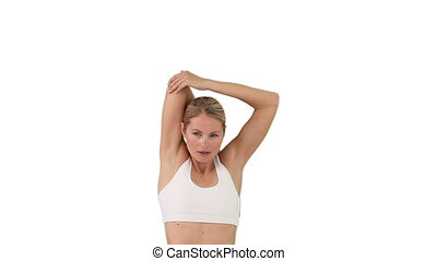 Wonderful woman in sportwear doing exercise