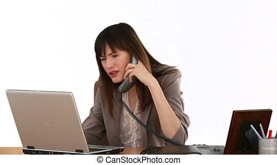 Businesswoman working on her laptop at her desk