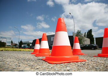Orange cones in a urban environment - Orange plastic cone...