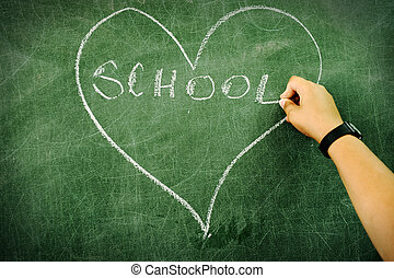 Child drawing and writing on board: heart and school