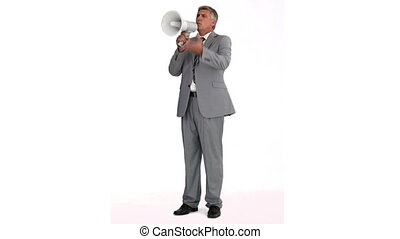 Businessman speaking in a megaphone against a white...