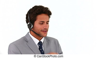 Man in a call center talking on the phone