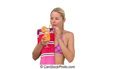 Pretty woman in swimsuit drinking cocktail and it's making her happy