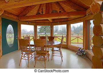 Rustic log cabin on the horse farm dining room and kitchen -...
