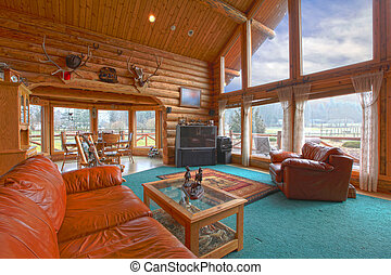 Large living room in the rustic log cabin on the horse farm