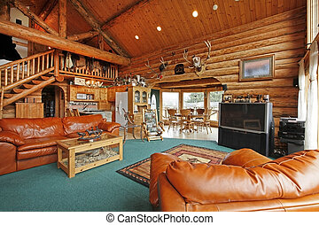 Large living room of the log cabin with cowboy style