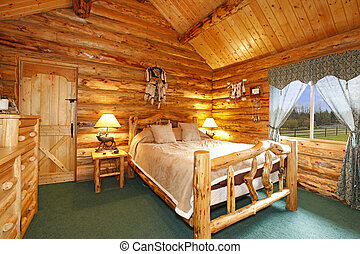 Log cabin bedroom with rustic wood design