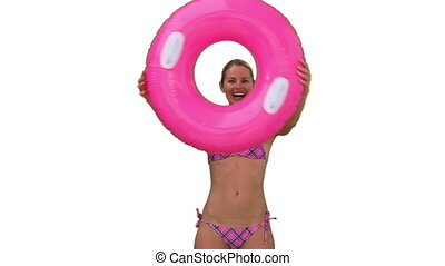 Woman in a pink swimsuit playing with a rubber ring