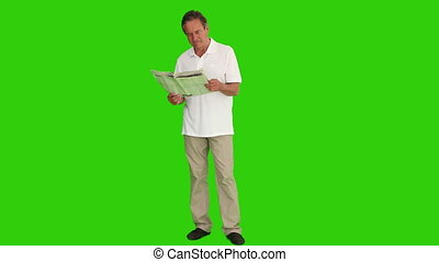 Retired man reading a funny article - Chroma-key footage of...