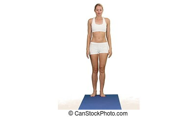 Attractive woman doing exercise on a ground cloth