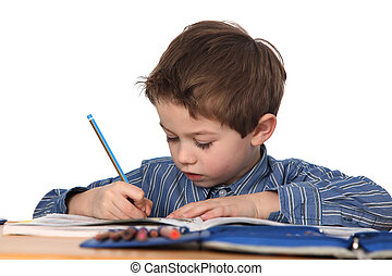 young boy learning - cute young boy learning with white...