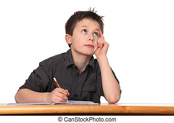 young boy learning - cute young boy doing homework